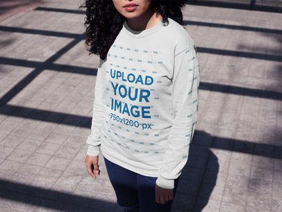 Young Girl Under a Roof Shadow Wearing a Long Sleeve T-Shirt Mockup a15969