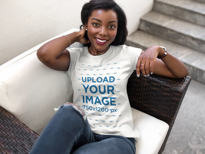 Beautiful Young Girl Wearing a Round Neck Tee Mockup While Lying on a Sofa a16059