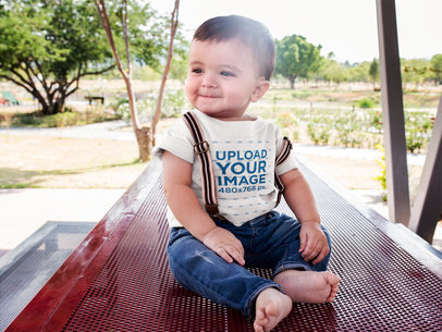 Happy Baby Wearing a Round Neck Tshirt Mockup and Suspenders a16104