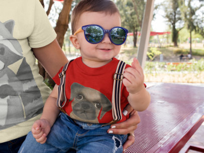 Little Baby Boy Wearing Big Sunglasses and a Round Neck Tee Mockup with His Mom a16080