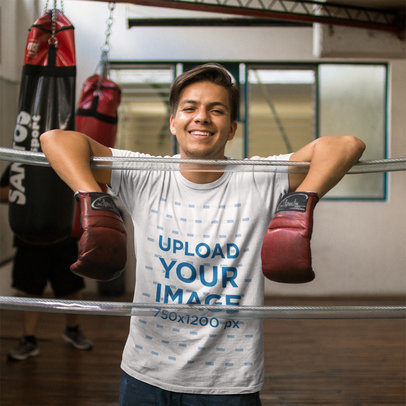 Mockup of a Customer Showing his New T-Shirt Mockup While in a Boxing Class a16223