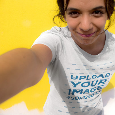 Selfie of a Young Girl Wearing a Round Neck Tee Template While Against a Yellow Wall a16234