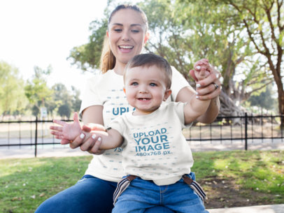 Mom and her Baby Playing in the Park While Wearing Different Round Neck Tees Mockup a16100