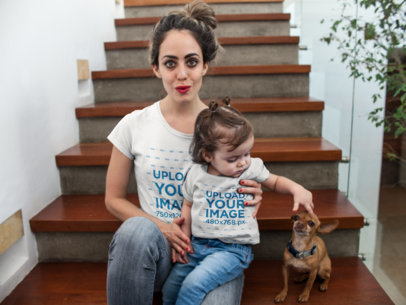 Pretty Mom and her Girl Wearing Different T-Shirts Mockup While in Wooden Stairways with a Dog a16087