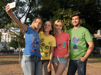 Group of Four Friends Taking a Selfie at the Park While Wearing Different Round Neck Tees Mockup a16278
