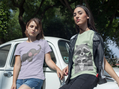 Two Girlfriends Wearing Round Neck Tees Template While Against a White Vintage Car a16244