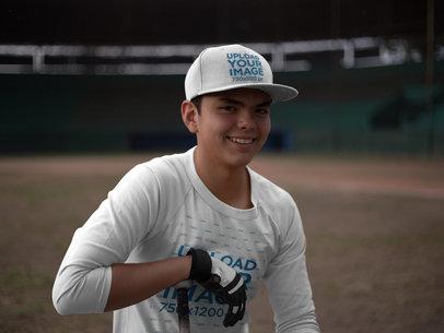 Smiling Hitter Boy Wearing a Baseball Hat Mockup and a Raglan Tshirt at the Field a16180
