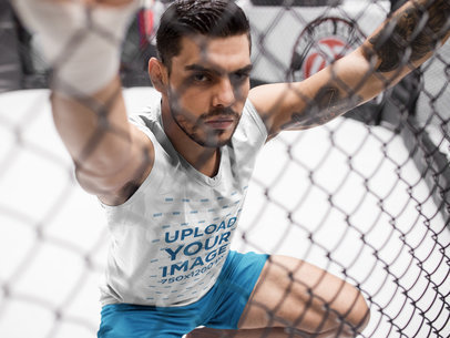 MMA Fighter Holding the Cage While Wearing Custom Sportswear Mockup a17040