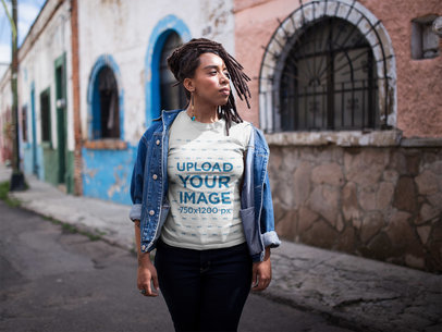 Dreadlocked Girl Wearing a T-Shirt Mockup While Walking in the Street a17142