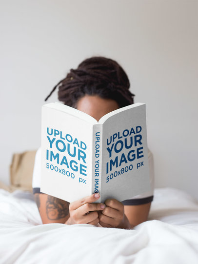Girl with Dreadlocks Reading a Book Mockup While in Bed a17301