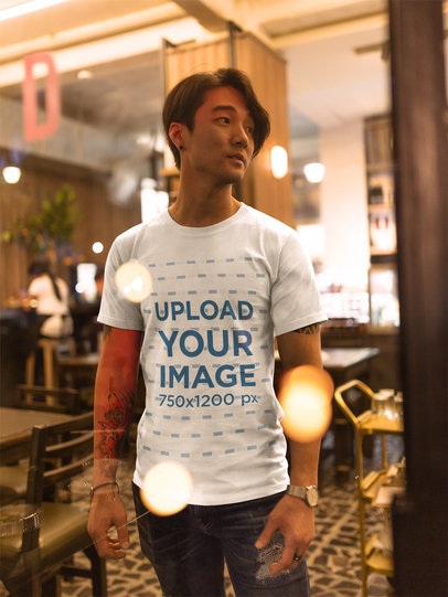 Asian Fashion Man Wearing a T-Shirt Mockup While at a Restaurant a17807