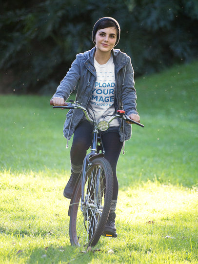 Girl Wearing a Tshirt Template Riding her Bike Outdoors a17934