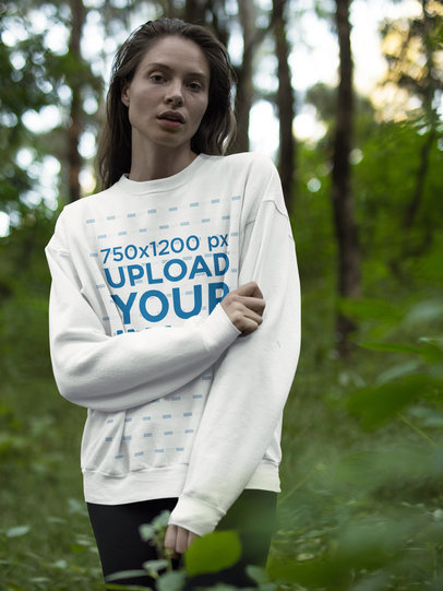 Beautiful White Woman Wearing a Crewneck Sweatshirt Template While in the Woods a17912