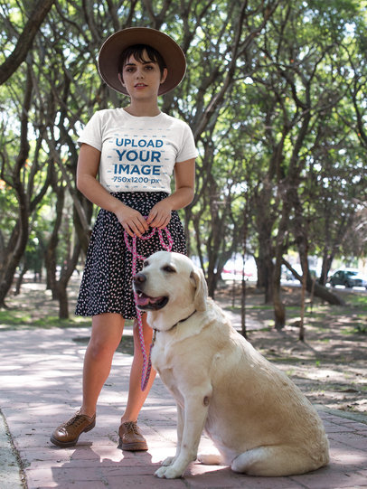 Mockup of a Girl Wearing a Tee with her Dog at the Park a17986