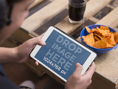 Teenager Playing With iPad Mini And Eating Chips Tablet Mockup