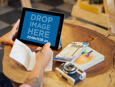 Young Woman at a Hip Coffee Shop Using an iPad Mockup  a5112