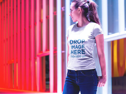 T-Shirt Mockup of a Girl in Front of an Illuminated Wall a6603