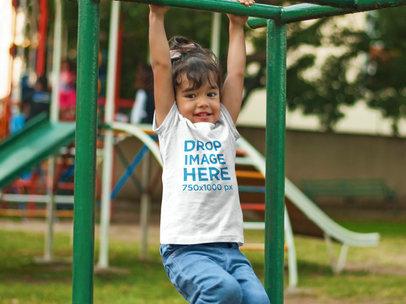 Young Girl Playing at the Park T-Shirt Mockup a7704