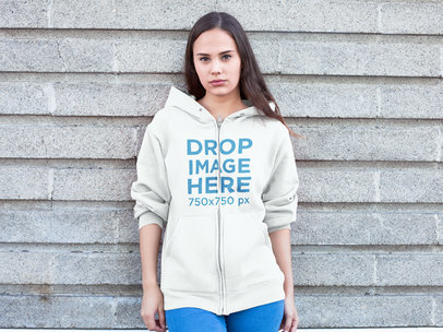 Clothing Mockup of a Woman in a Hoodie Against a Wall a7880