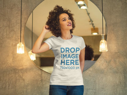 Woman Standing in Front of a Mirror T-Shirt Mockup a8337