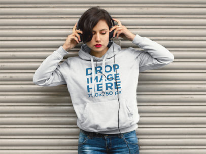 Hoodie Mockup of an Indie Girl Listening to Music a9244