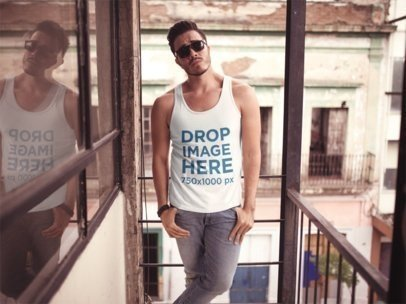 Mockup of a Trendy Guy Wearing a Sleeveless Tee in a Downtown Building a11864