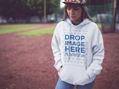 Pullover Hoodie Mockup Featuring a Young Hispanic Girl in the Park a12455