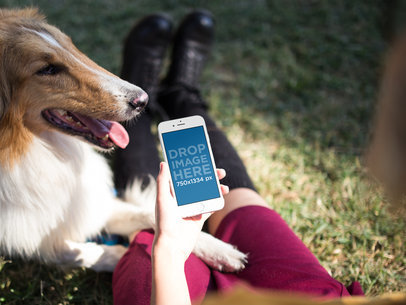 White iPhone Mockup of a Woman at a Park with her Dog a12805wide