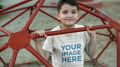 Little Boy Playing at the Jungle Gym Wearing a Kid's Round Neck Tee Video Mockup a12774