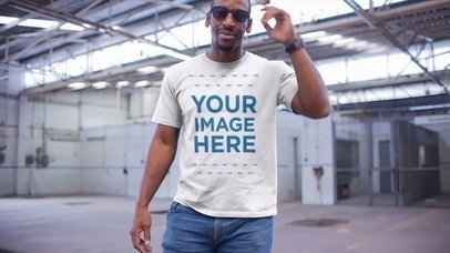 Middle Aged Black Man Wearing a Round Neck Tee in a Warehouse Apparel Mockup Video a13120-122916