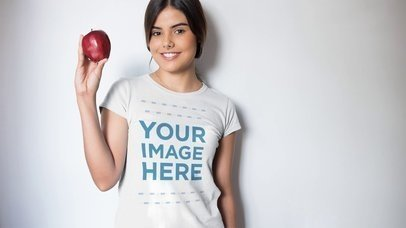 Beautiful Girl Eating an Apple Wearing a T-Shirt Apparel Video a13230