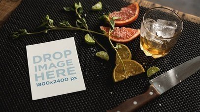 Flyer Lying On Table With Knife And Lemon While Glass Ice Is Moving a13723