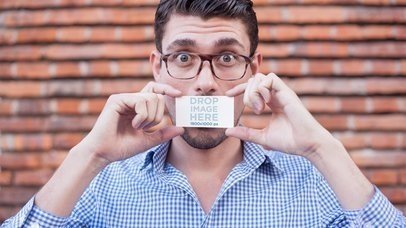 Young Dude Being Funny While Holding A Business Card Stop Motion Mockup a13851