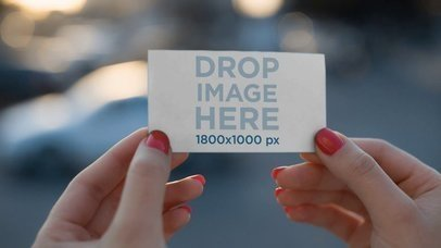 Video Mockup Of A Business Card Being Held By A Girl a13917