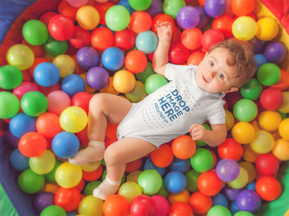 Pretty Baby Having Fun At A Ball Pit Wearing A Onesie Mockup a14021