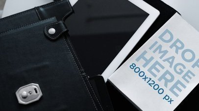 Video Mockup Hovering Over A Book Lying Near A Black Briefcase a14151