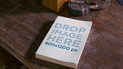 Video Hovering over a Book Lying on an Old Wooden Table Mockup a13925