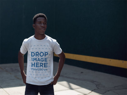Mockup of a Young Black Man Wearing a Round Neck Tshirt While At The Fronton Court a14254