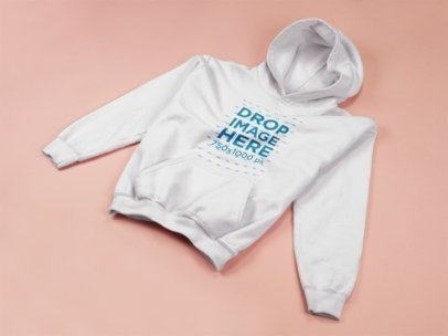 Pulllover Hoodie Template Lying on a Flat Pink Surface a15242