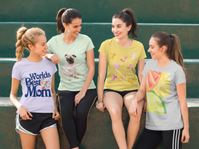 Group of Four Girlfriends Wearing Different Tshirts Mockup While Sitting on Big Green Stairways a15735