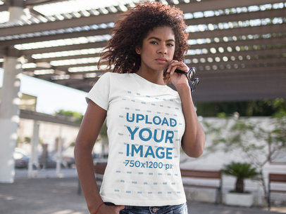 Black Girl Wearing a Round Neck T-Shirt While Holding her Glasses Outdoors a15806