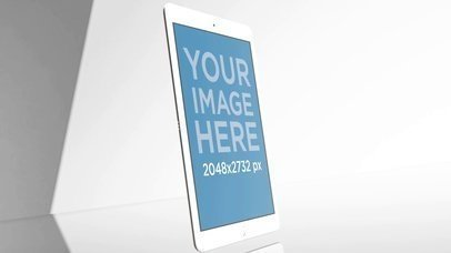 Angled White iPad Mockup Video Standing in a Gray Room a15794