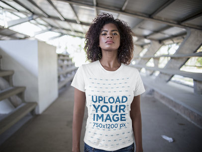 Young Woman with Defying Look Wearing a Round Neck Tee Mockup in the City a15832