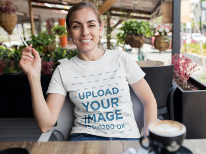 Middle Aged Woman Smoking at a Cafe While Wearing a Round Neck Tee Mockup a15869