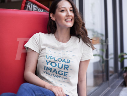 Woman Wearing a Round Neck T-Shirt Template While Sitting Down Outdoors a15918
