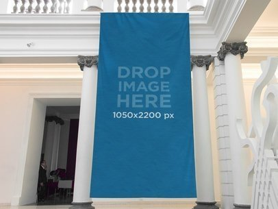 Vertical Banner Mockup Hanging From a Balcony at a Museum a10567
