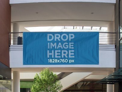 Horizontal Banner Mockup Hanging From a Balcony at a Mall a10632