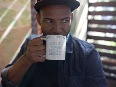 Mug Mockup of a Young Black Man Drinking a Hot Beverage a12294