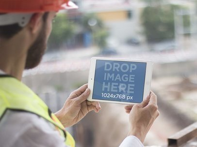 iPad Mini Mockup of an Onsite Construction Worker a12417