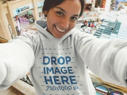 Hoodie Mockup of a Woman at the Mall Taking a Selfie a12925
